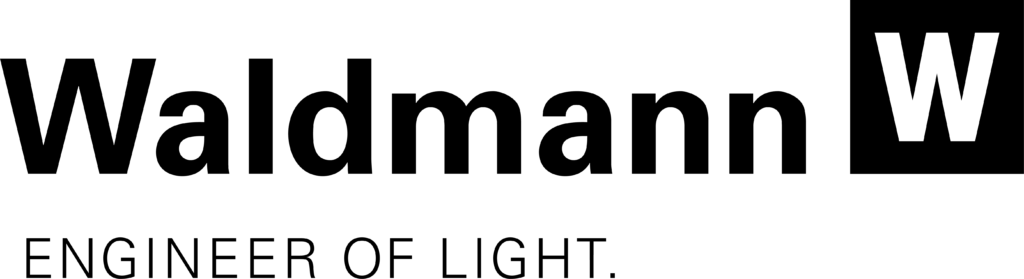 Logo Waldmann spécialiste des éclairages pour l'industrie avec plusieurs gammes : éclairage poste de travail, éclairage machine, éclairage bureaux
